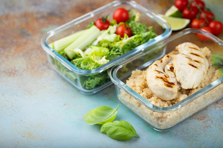 Healthy meal prep containers with quinoa, chicken breast and green salad overhead shot with copy space. 版權商用圖片