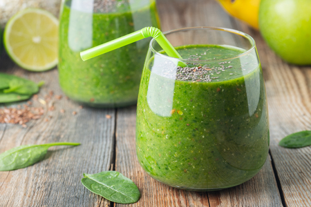 Green fresh healthy smoothie with fruits and vegetables. diet detox concept.