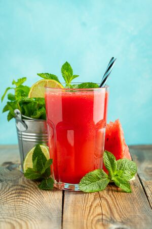 Watermelon slushie with lime and mint, summer refreshing drink in tall glasses on a light blue background. Sweet cold smoothie. Stock fotó