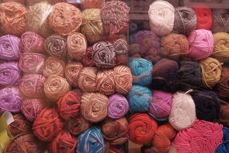 fancywork: rows of meny colorful wool threads in the shop