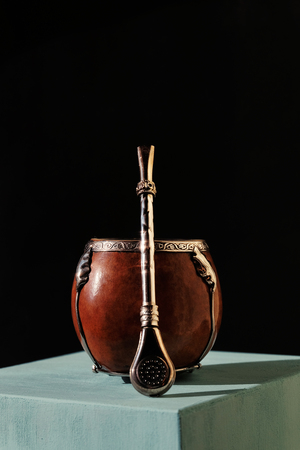Beautiful calabash and bombilla on a dark background