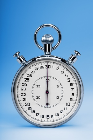 Mechanic chromed stopwatch on blue background. Front view.  Stock Photo