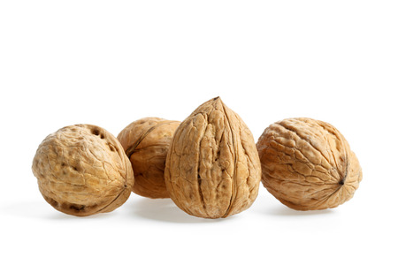 Four nuts on white background Stock Photo