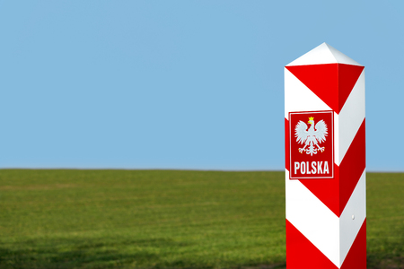 Border post with the emblem of the Polish.
