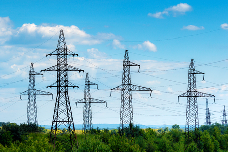 Electric power transmission lines with a blue sky.