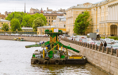 Reclaimed: The moored platform for dredging.  Russia, St.-Petersburg, the river Fontanka.