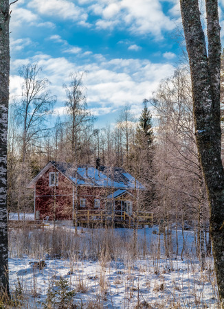 House in winter forest on a clear, sunny day. Editorial