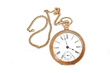 pocketwatch: golden pocketwatch on white surface Stock Photo