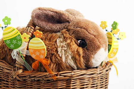 Easter rabbit with decorative eggs in the basket photo