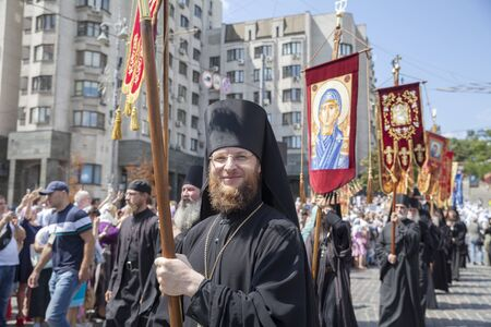 Kiev, Ukraine - July 27, 2019: Orthodox monks in black go at the head of the procession on the day of the baptism of Rus. Editorial