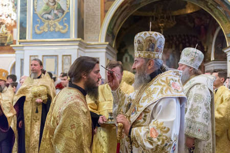 Kiev, Ukraine - July 11, 2018: His Beatitude Metropolitan of Kiev and All Ukraine Onufriy (Berezovsky) the anointing of a monk at an evening service at the Kiev Pechersk Lavra.