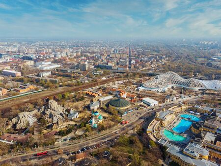 Beautiful top view of the zoo, Szechenyi baths, a mosque in Budapest. Top view of the railway, houses and city park. Spring. Blue sky and beautiful clouds in the background.