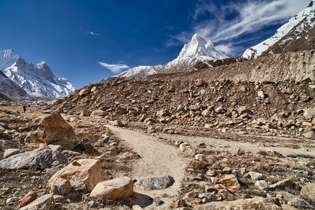 Country road in the mountains. Himalayas. Gangotri, Gaumukh, India. Stock Photo
