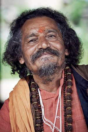 jainism: Naggar, INDIA - JULY 17: Portrait of Brahmin. Smiling Indian Brahmin. Indian man poses for photo. July 17, 2013 in Naggar, Kullu Valley, Himachal Pradesh, India.