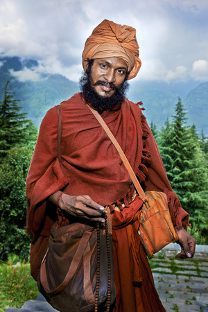 jainism: Naggar, INDIA - JULY 17: Portrait of young yogi. Indian Brahmin. Indian man poses for photo. July 17, 2013 in Naggar, Kullu Valley, Himachal Pradesh, India. Editorial