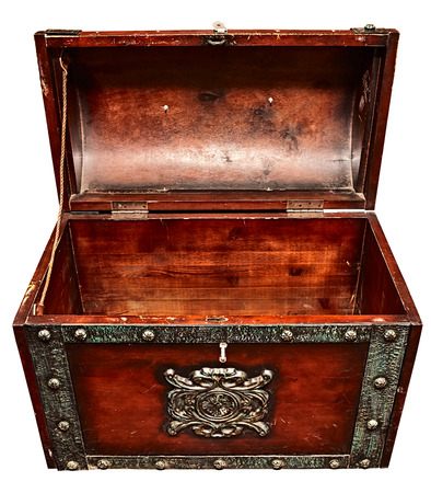 Old wooden trunk with the lid open, close up high angle view, isolated on white.