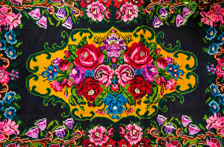 Moldovan National woven carpet, ornament with flowers roses, view straight. Stock Photo