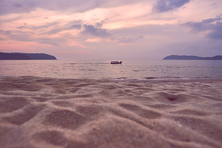 Pink colorful sunset on tropical island with boat. Panoramic view. Langkawi island.