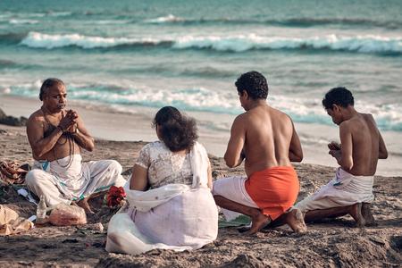 Varkala, Kerala, India - Nov 30, 2017: Diwali festival. Diwali celebration on Varkala beach. Peoples come to  brahmanas for perform puja and make offerings to God through the ocean.
