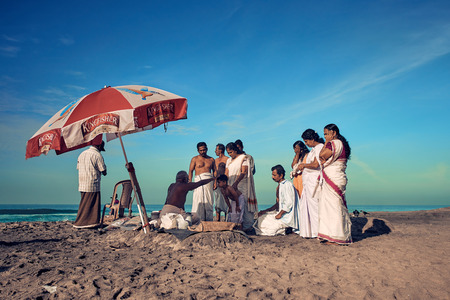 Varkala, Kerala, India - Nov 30, 2017: Varkala beach. Peoples come to brahmanas for perform puja and make offerings to God through the ocean.