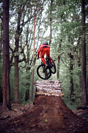 Moscow, Russia - October 07, 2018: Jump and fly on a mountain bike. Rider in action at mountain bike sport. Biker riding in nature. Cool athlete cyclist on a bike. MTB biking. Redakční