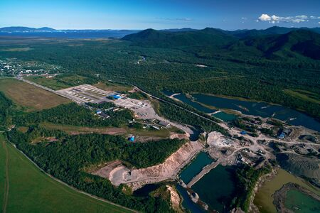 Aerial view over the sandstone quarry. Large Quarry from above during work hours. Industrial place in Russia.