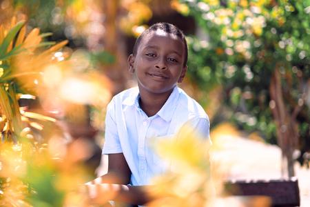 Kuala Lumpur, Malaysia - Jul, 2019: African boy in park.