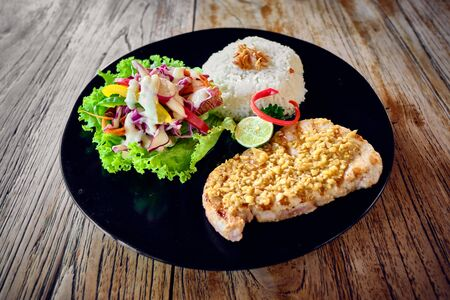 Grilled tuna steak with rice and vegetables.