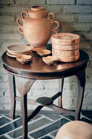 Amphora vase set in interior. Decorative ceramic pottery in a art store.