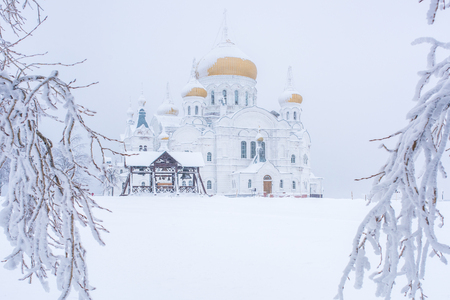 Russian church covered with snow at frosty winter day Imagens