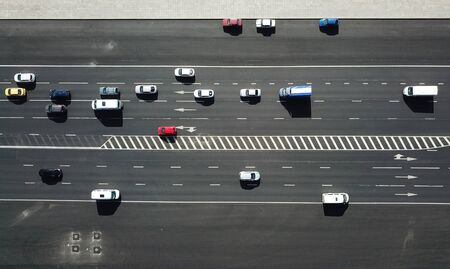 Aerial drone shot of the traffic on the road at sunny day