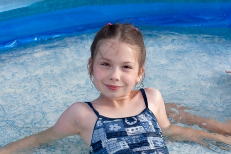portrait of the little girl in swimming pool