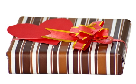 striped box with ribbon and heart shaped paper note for text