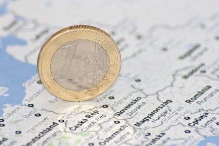 europe closeup: one euro coin on the map of Europe, close-up
