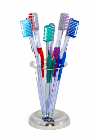five toothbrushes in a metal holder