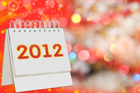 calendar with 2012  sign over Christmas background  photo