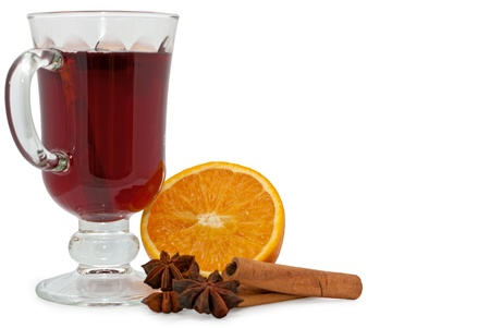 Christmas hot wine with orange, star anise and cinnamon over white background  photo