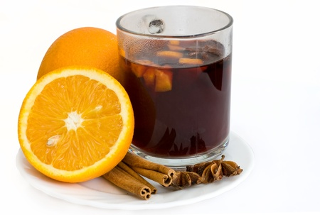 Christmas hot wine with oranges over white background