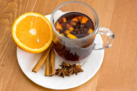 Christmas hot wine with oranges on wooden table  photo