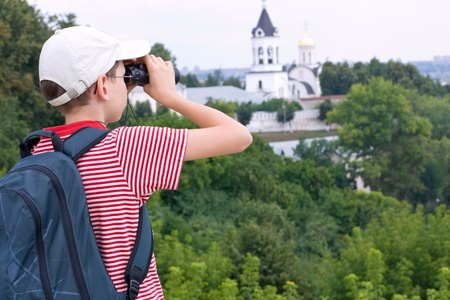 Boy with binoculars and backpack on a hike  Stock Photo - 11432279