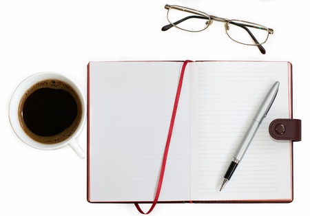 cup of coffee, notebook and glasses on white background  photo