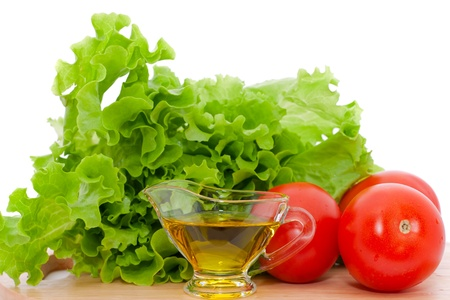 olive oil, salad and tomatoes  Stock Photo