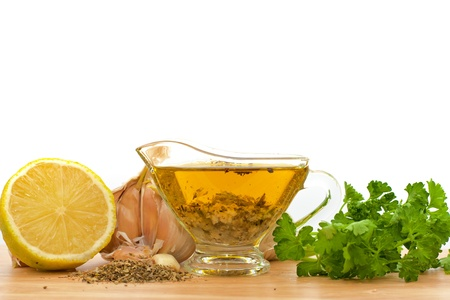 salad dressing with olive oil, garlic and lemon  Stock Photo