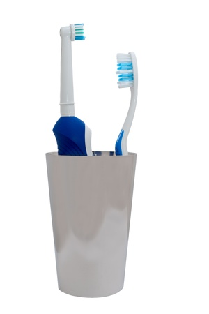 electric toothbrush and usual toothbrush over white background