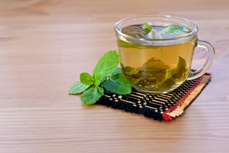 green tea with mint on wooden table  photo