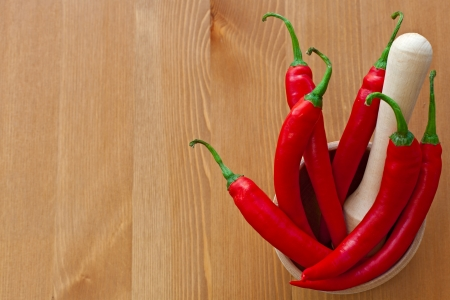 pounder: hot red peppers and wooden pounder