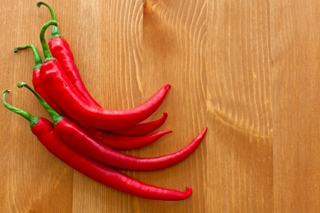 hot red peppers on wooden table Stock Photo