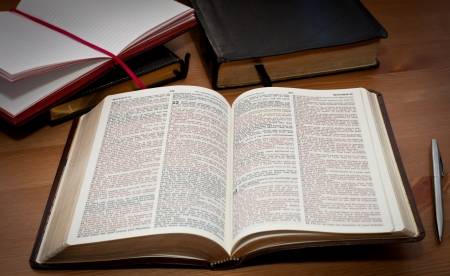 open bible on the table photo