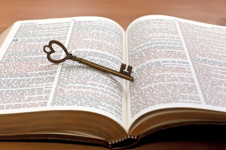 key on the Bible page Stock Photo