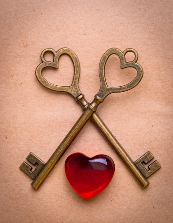 two keys and heart over old paper photo